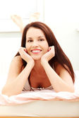 Beautiful woman resting in the bed. — Stock Photo