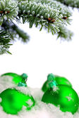Christmas evergreen spruce tree and green glass ball — Stock fotografie