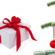 Christmas  tree over gift with red ribbon — Stock Photo