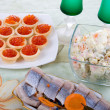 Stock Photo: Festively set table with red caviar and salads