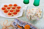 Festively set table with red caviar and salads — Stock Photo