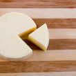 Cut round cheese — Photo