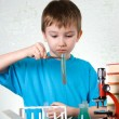 Boy plays in the academic chemist — Stock Photo