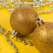 Christmas decor on a yellow background — Stock Photo