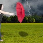 Woman Holding Umbrella — Stock Photo #7107111