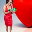 Black Woman Opening a Valentines present — Stock Photo