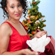 图库照片: Black WomOpening Christmas or birthday present