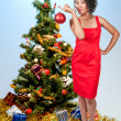 Black Woman Holding a Christmas Ornament — 图库照片