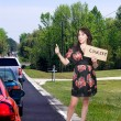 Woman Hitch Hiking to a Concert — Stok fotoğraf