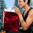 Woman Holding a Christmas Ornament — Stock Photo