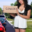 Woman Hitch Hiking to a Concert — Stock Photo #7410624