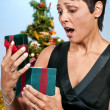 Stock Photo: Beautiful Woman Holding Gift