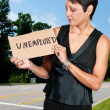 Foto Stock: WomHolding Unemployment Sign