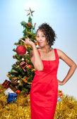 Black Woman Holding a Christmas Ornament — Stock Photo