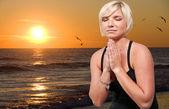 Woman praying — Stock Photo