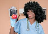 Female Doctor Holding Apple — Stockfoto