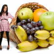 Royalty-Free Stock Photo: Pregnant Black Woman and a Fruit Cornucopia