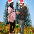 Black Couple Opening a Christmas or birthday present — Stock Photo #7891152
