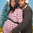 Black Couple wearing Christmas Santa Hats — Stock Photo