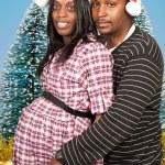 svart par bär christmas santa hattar — Stockfoto