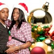 Black Couple wearing Christmas Santa Hats — Stockfoto