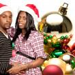 Black Couple wearing Christmas Santa Hats — Stock Photo #7891246