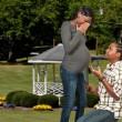 Black man proposing to a pregnant woman — Stock Photo