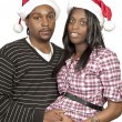 Black Couple wearing Christmas Santa Hats — 图库照片