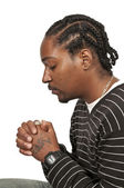 Black man praying — Stockfoto