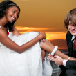 Man with Garter on Black Woman — Stock Photo