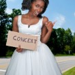 Woman Hitch Hiking to a Concert — Lizenzfreies Foto