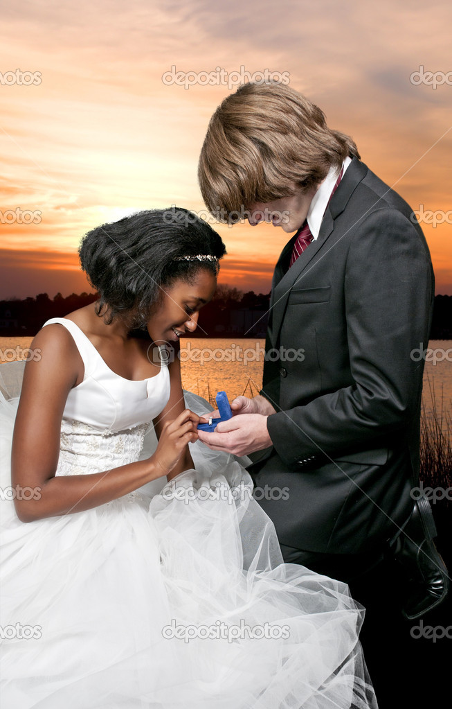 Caucasian man proposing marriage to a black African American woman — Stock Photo #7904865