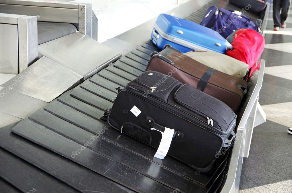 Suitcases on a luggage band on the airport  Stock Photo #6875146