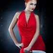 Girl red dress with knife — Stock Photo #7776715