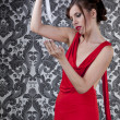Girl red dress with knife — Stock Photo