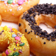Tasty colorful donuts - Foto Stock