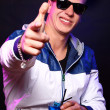 Young stylish guy in the nightclub — Stock Photo