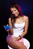 Young and beautiful woman in the nightclub — Stock Photo