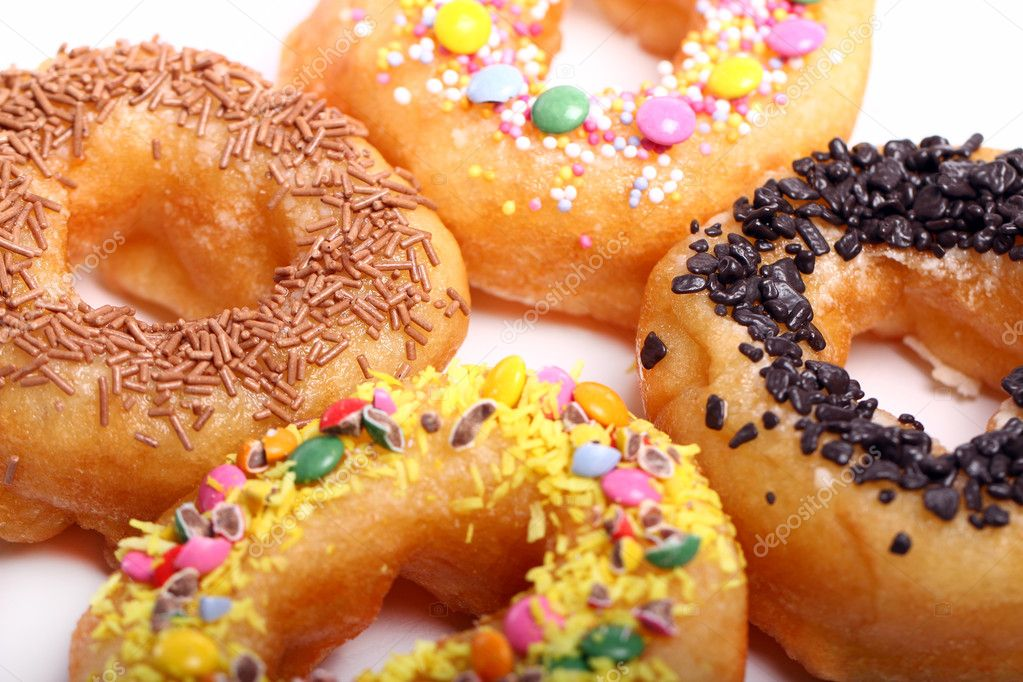Tasty colorful donuts on the table — Stock Photo #6763463
