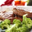 Tasty steak with vegetables - Stock Photo