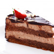 Slice of tasty chocolate cake with strawberry on top — Stock Photo #6882566