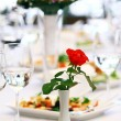 Red rose on banquet table — Stock Photo