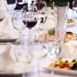 Wine glasses on banquet table — Stock Photo
