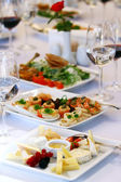 Different snacks for wine on banquet table — Stock Photo