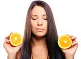 Beautiful woman with orange in hands — Stock Photo