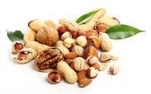 Close up of fresh hazelnuts and peanuts — Stock Photo