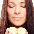 Beautiful woman with apple in hands — Stock Photo #6990169