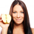 Beautiful woman with apple in hands — Stock Photo #6990197