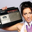 Freaky woman with old fashioned tape recorder — Stock Photo