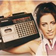 Freaky woman with old fashioned tape recorder — Stock Photo #7181568